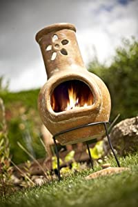 La Hacienda Clay Chiminea With Flower Cut Out Design Patio Heater from La Hacienda